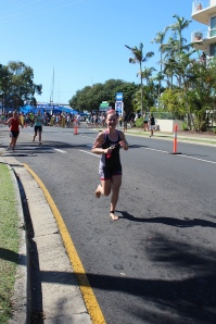 Run from swim to transition- can't stop smiling!